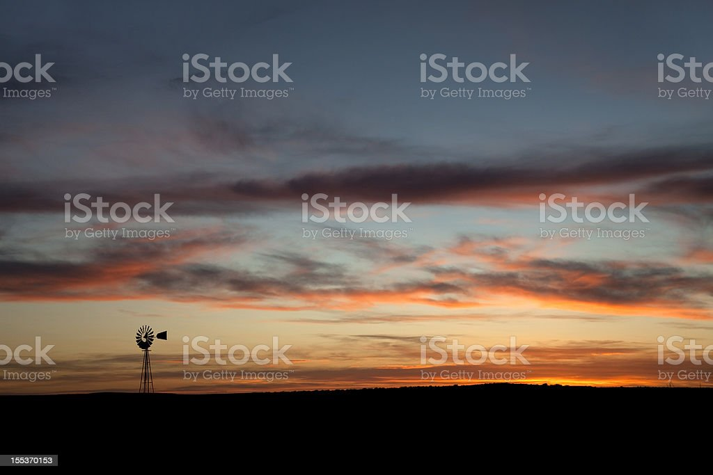 Windmill with Colorado sunset colors copy space royalty-free stock photo
