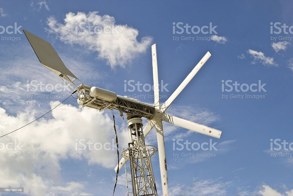 windmills against a blue sky, alternative energy source royalty-free stock photo