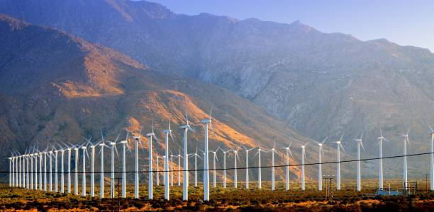 Windmills against the mountains stock photo