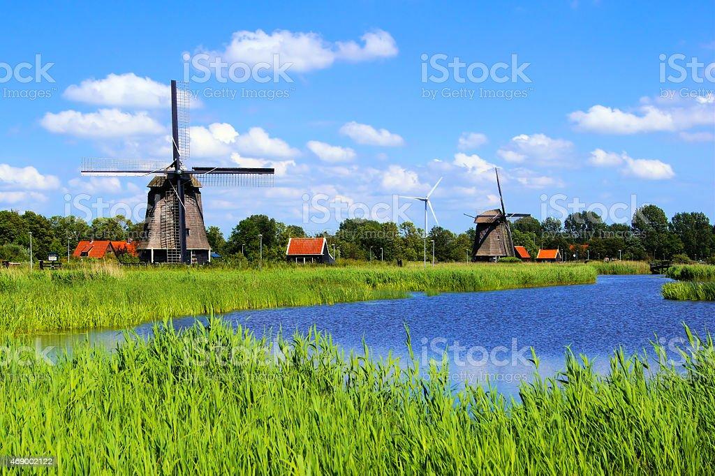 Windmills along a canal near Alkmaar, Netherlands stock photo