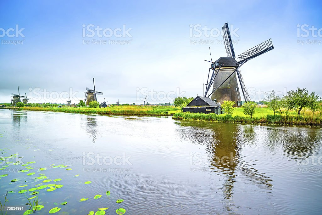 Windmills and canal in Kinderdijk, Holland or Netherlands. Unesc stock photo