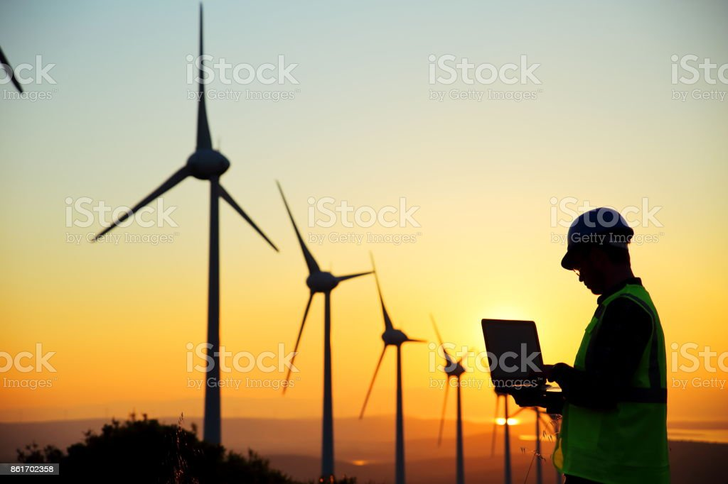 Windmills and engineer stock photo