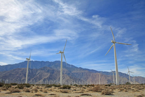 Windmills and mountains stock photo