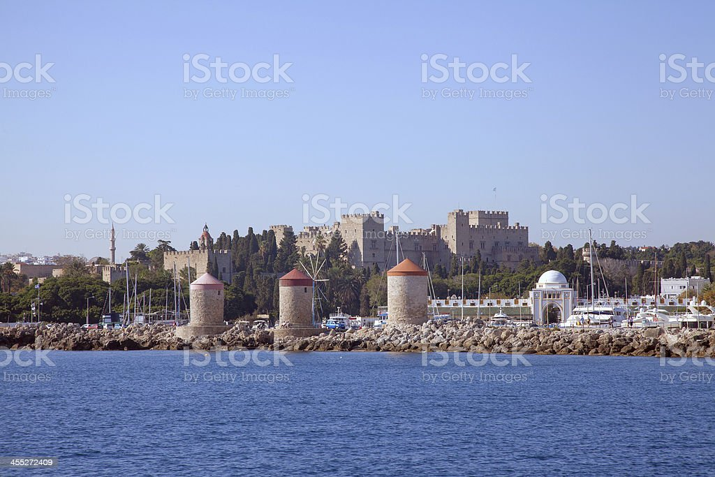 windmills and the palace of Rhodes, Greece stock photo