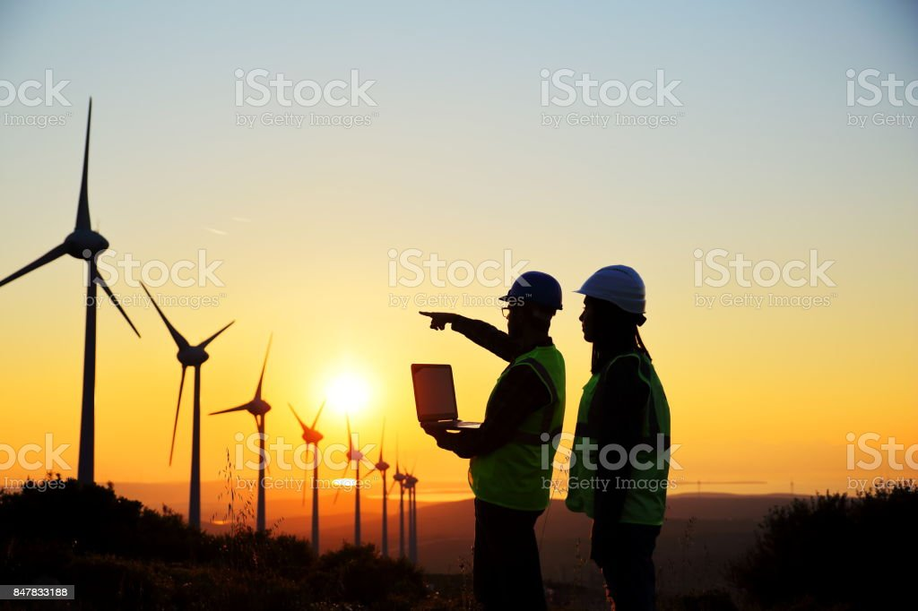 Windmills and Workers stock photo