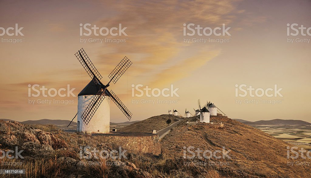 Windmills at sunset, Consuegra, Castilla La Mancha, Spain stock photo