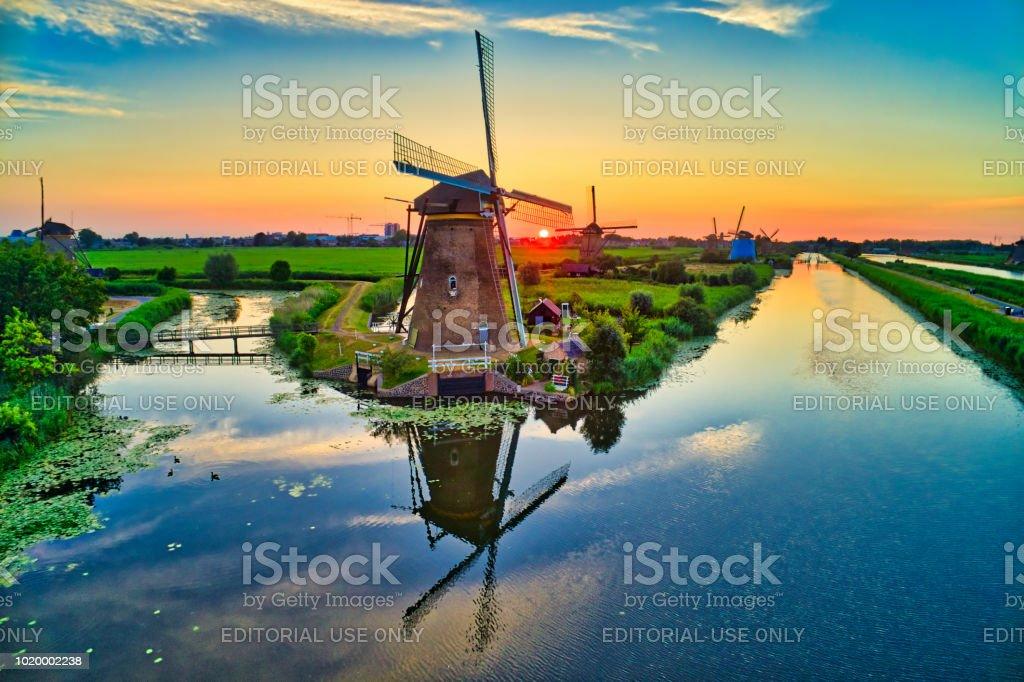 windmills at sunset in Kinderdijk, The Netherlands stock photo