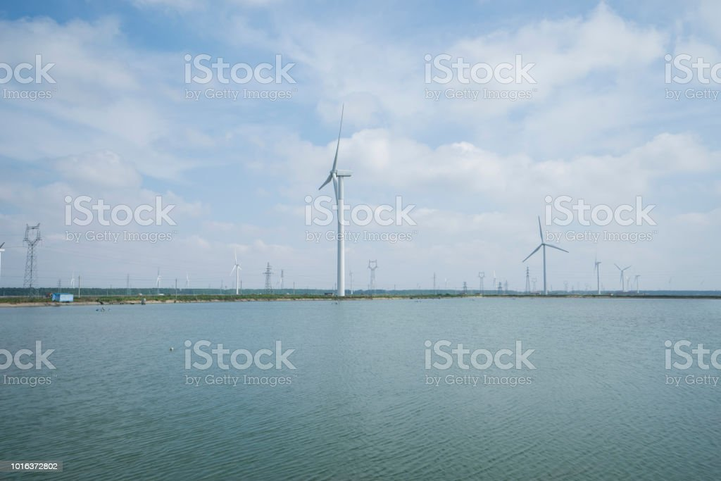 Windmills For Electric Power Production On Empty Farms Stock