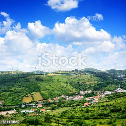 Wind turbine generator on top of hills in Portugal. Composite photo