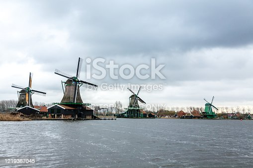Zaandam, The Netherlands - December 10, 2009: Windmills in the village Zaanse Schans on a cloudy day, The Netherlands