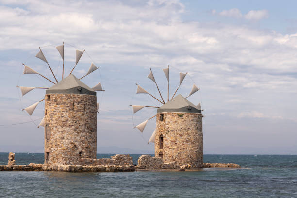 Windmills on Chios Island in Greece on windy day stock photo