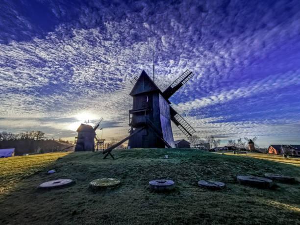 Windmills on the background of the interesting sky – zdjęcie