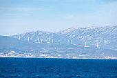 istock Windmills on the misty mountain 503110268