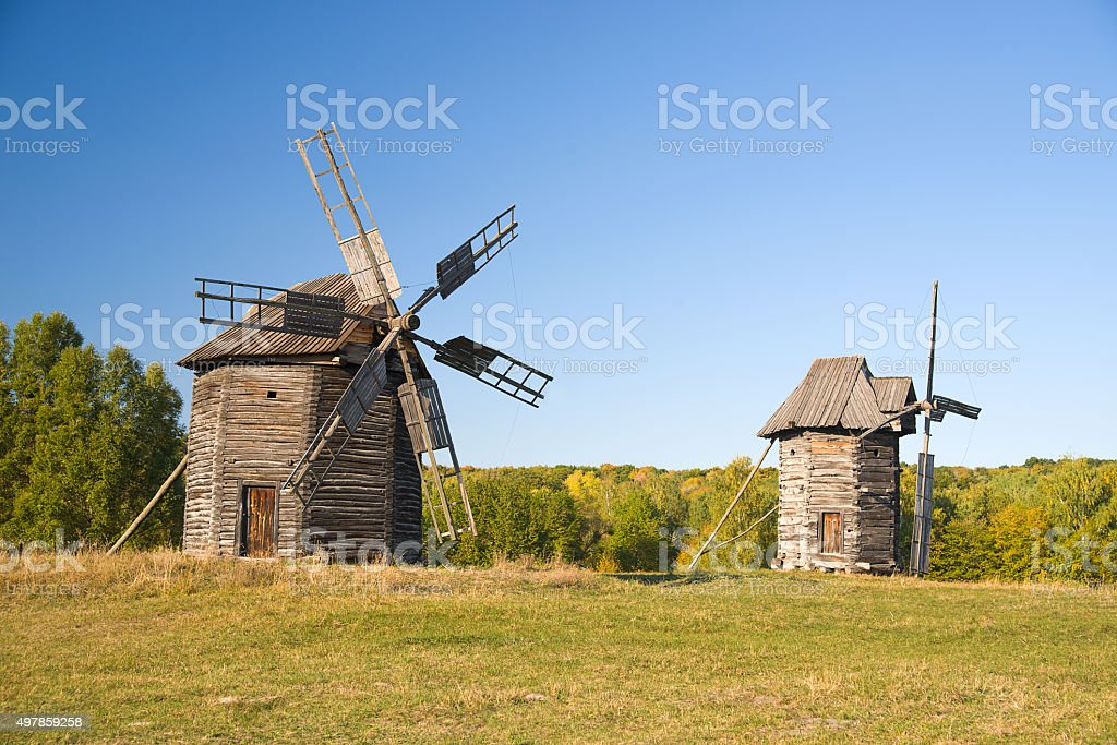 Windmills  standing on the edge of the autumn forest stock photo