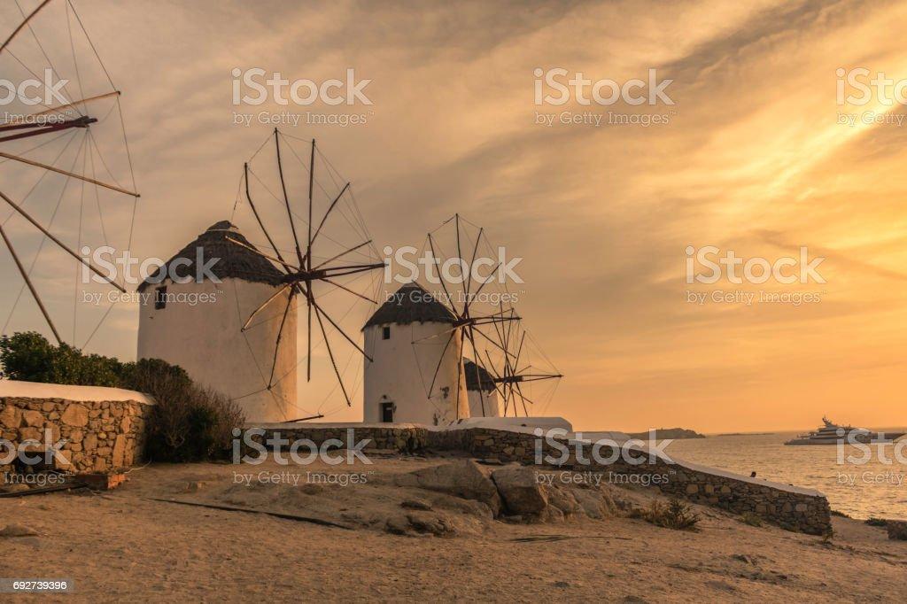 Windmills Sunset Mykonos greece island stock photo