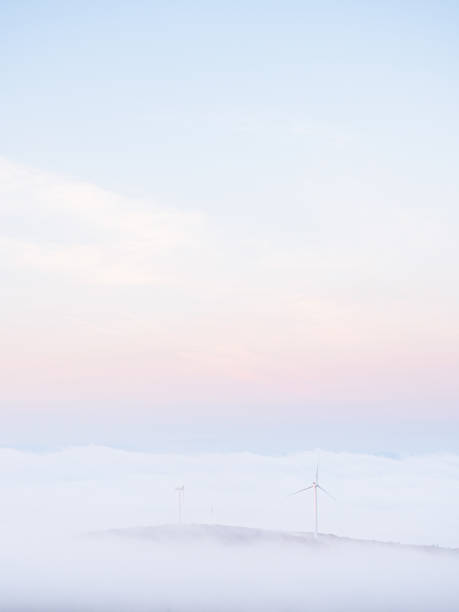 Windmills visible in the fog from Mount Wachusett in Massachusetts stock photo