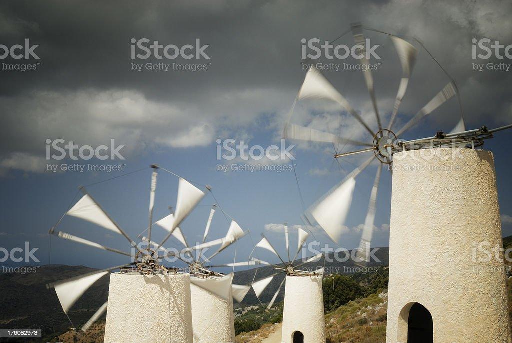 Windmills with rotating wind wheels in Kreta stock photo