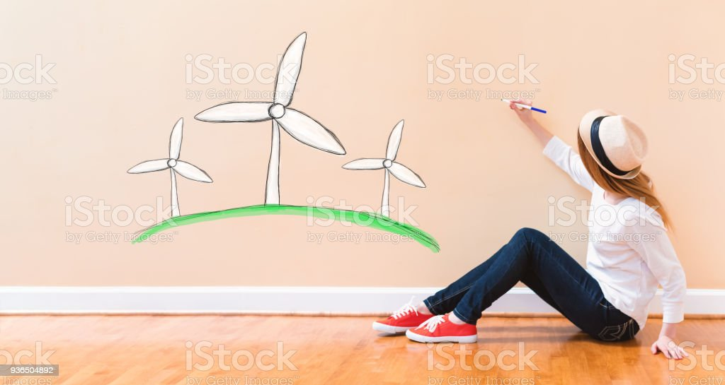 Windmills with young woman holding a pen stock photo
