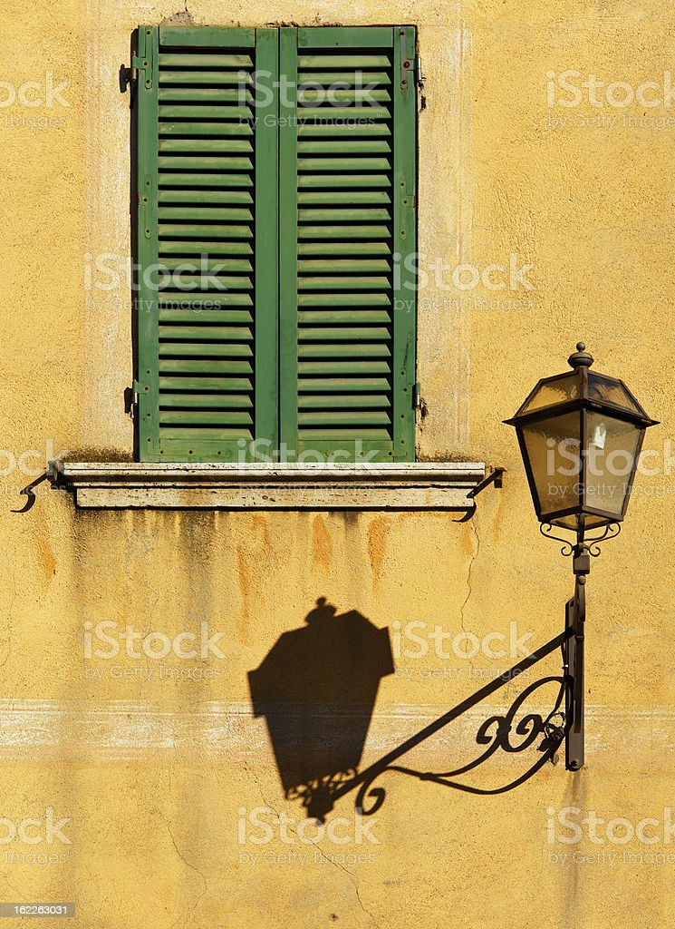 Window & street lamp in Tuscany stock photo