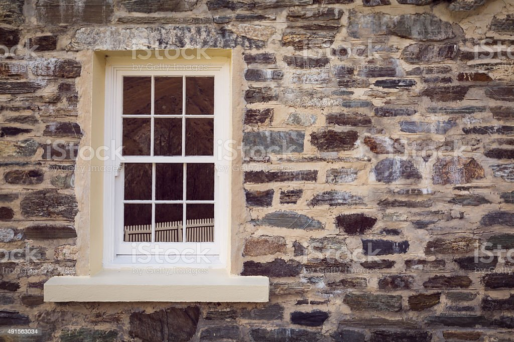 window and old stone wall stock photo