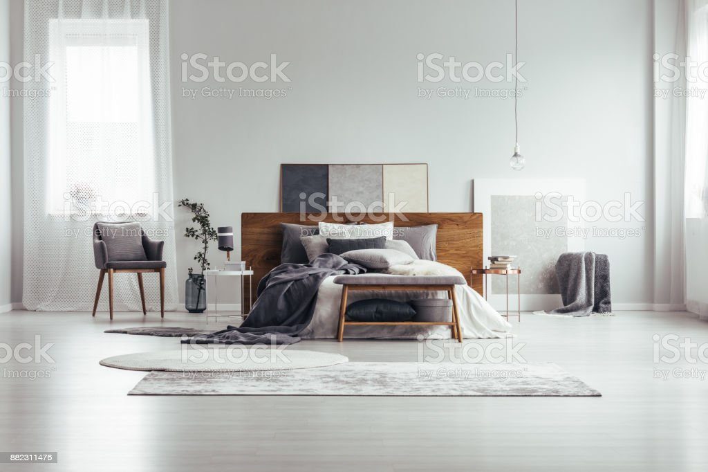 Window and paintings in bedroom stock photo