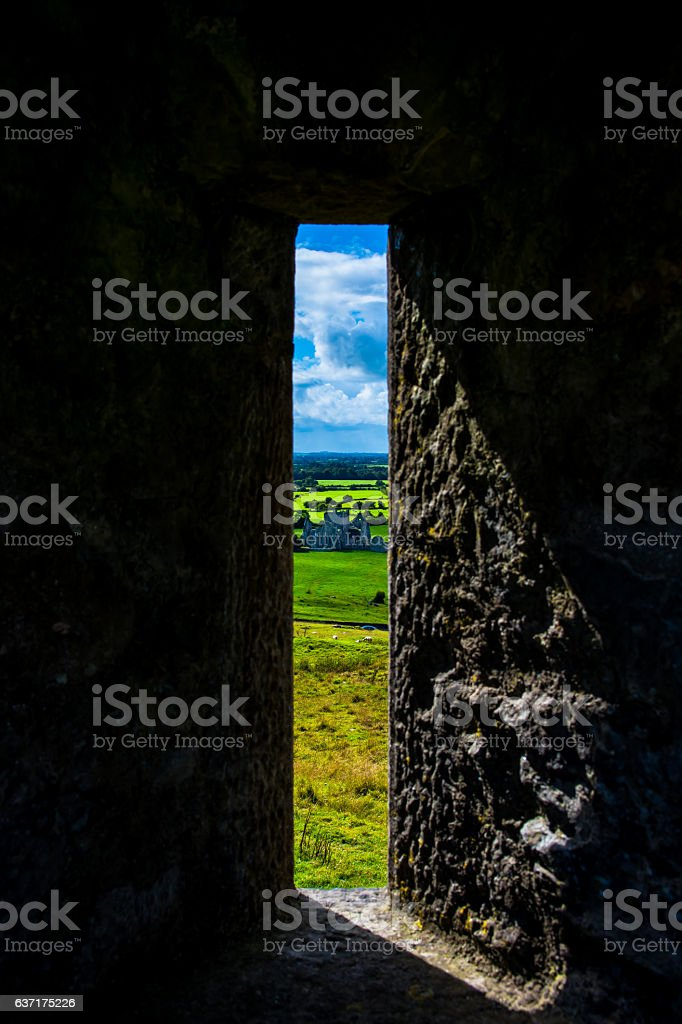 Window at Rock of Cashel with View Landscape in Ireland stock photo