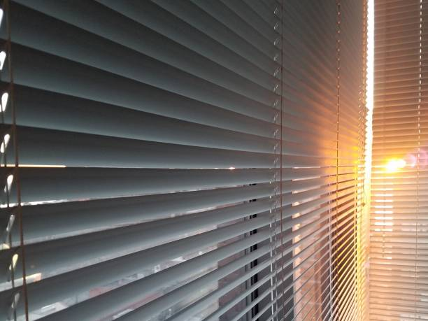 window blinds with sunlight flare - blinds stock pictures, royalty-free photos & images