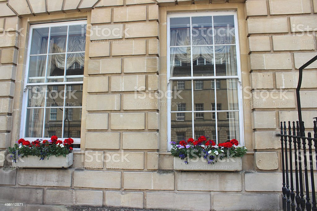 Window Boxes With Red Geranium Flowers On Georgian House Stock Photo
