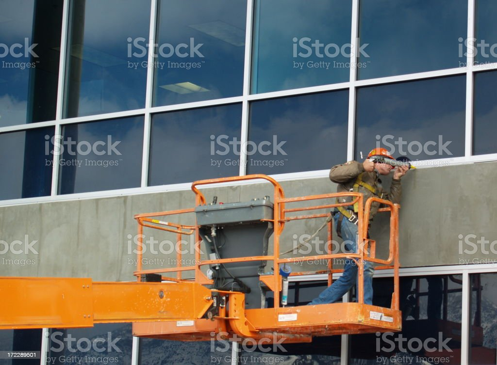 Window Caulking Construction Worker Man stock photo