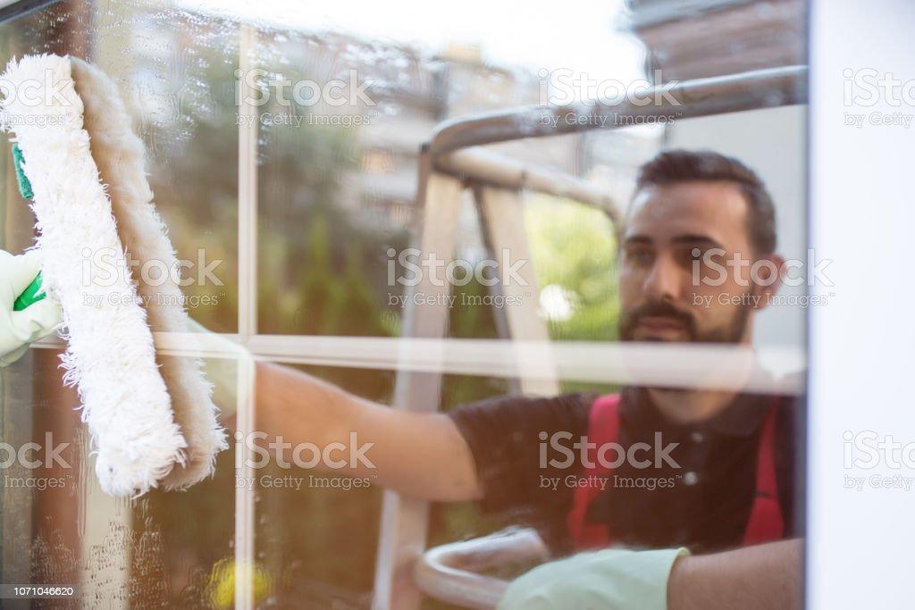 Window cleaner doing his job carefully stock photo