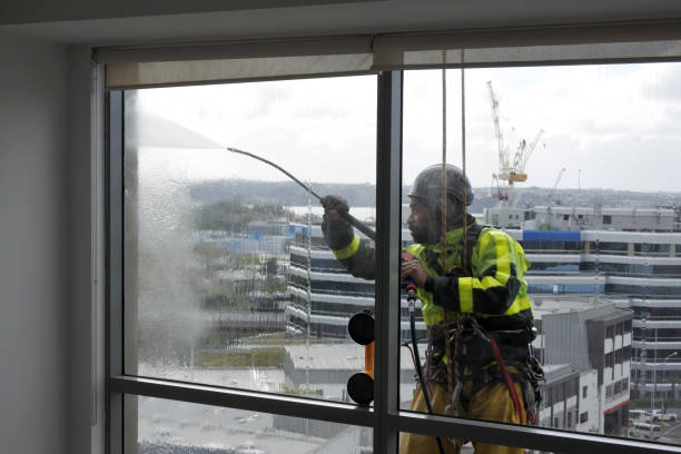 Window cleaning and washing service worker stock photo