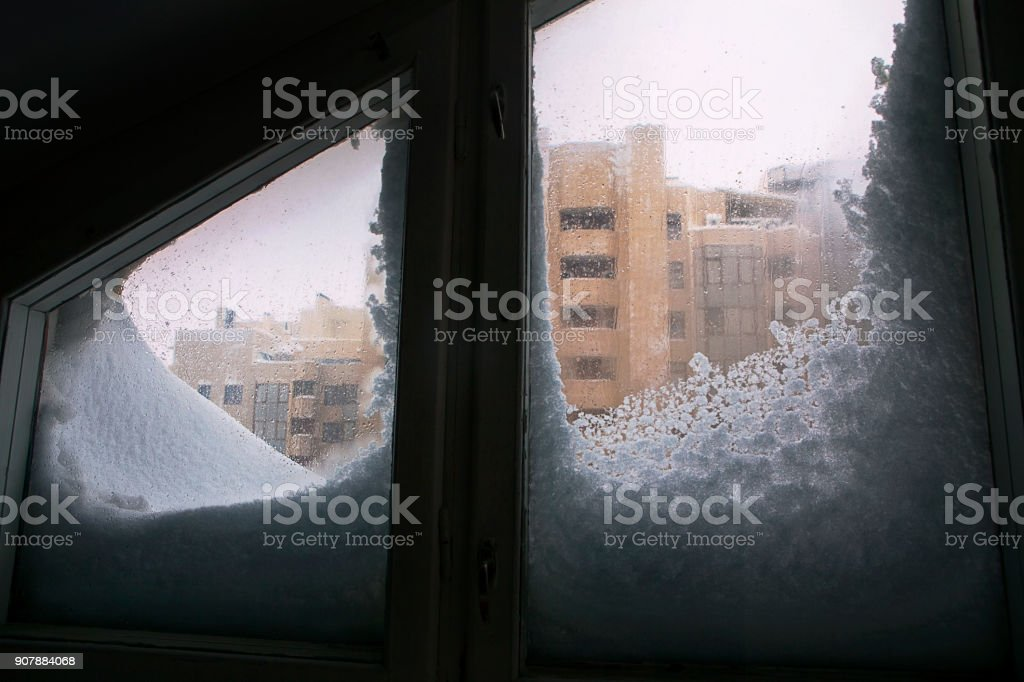 window covered with snow stock photo
