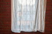 istock Window curtains in loft apartments 1266446133