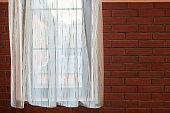 istock Window curtains in loft apartments 1269508510