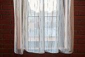 istock Window curtains in loft apartments 1269518071