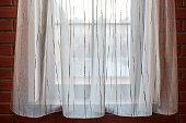 istock Window curtains in loft apartments 1269518103