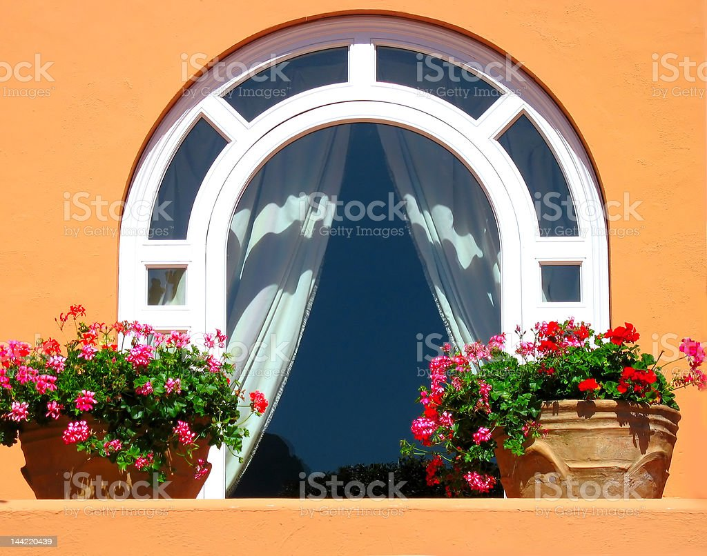 Window decorated with flowers royalty-free stock photo