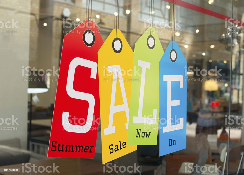 Window display for a summer sale stock photo