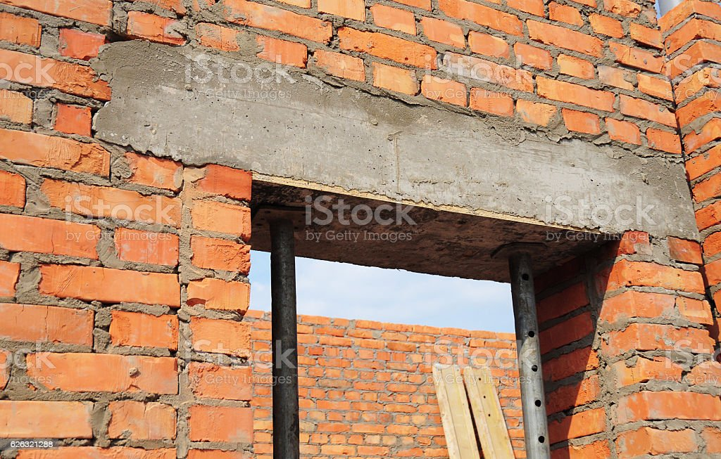 Window, door concrete lintel on brick unfinished house construction. stock photo