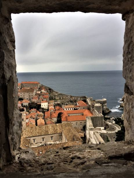 Window framing view of Old Town Dubrovnik and the Adriatic Sea stock photo