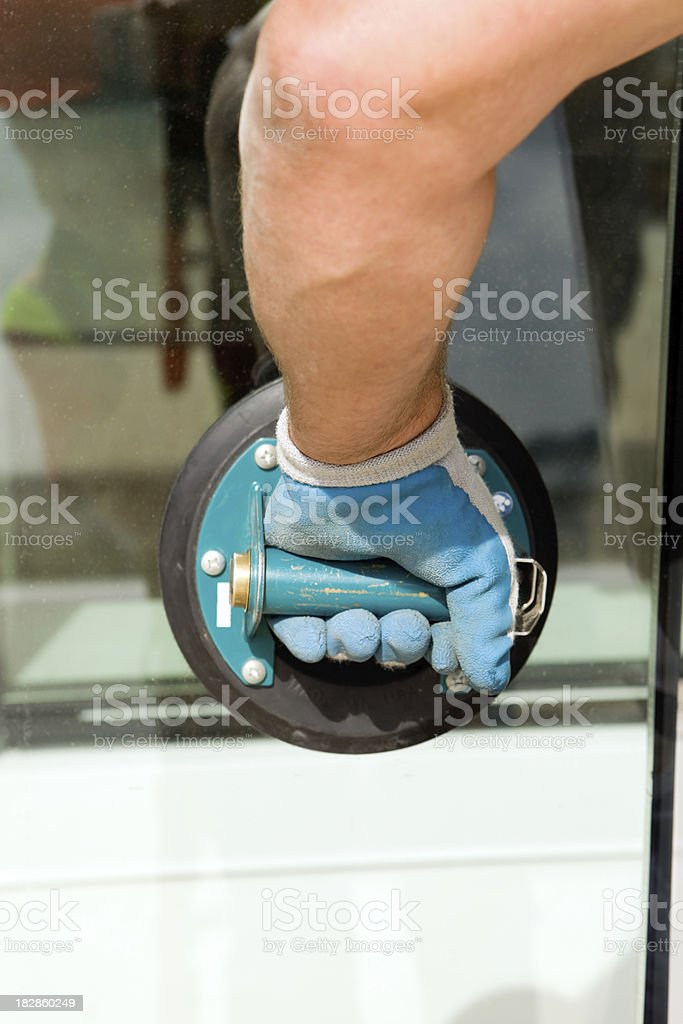 Window Glass Installer with a Hand-held Vacuum Cup royalty-free stock photo