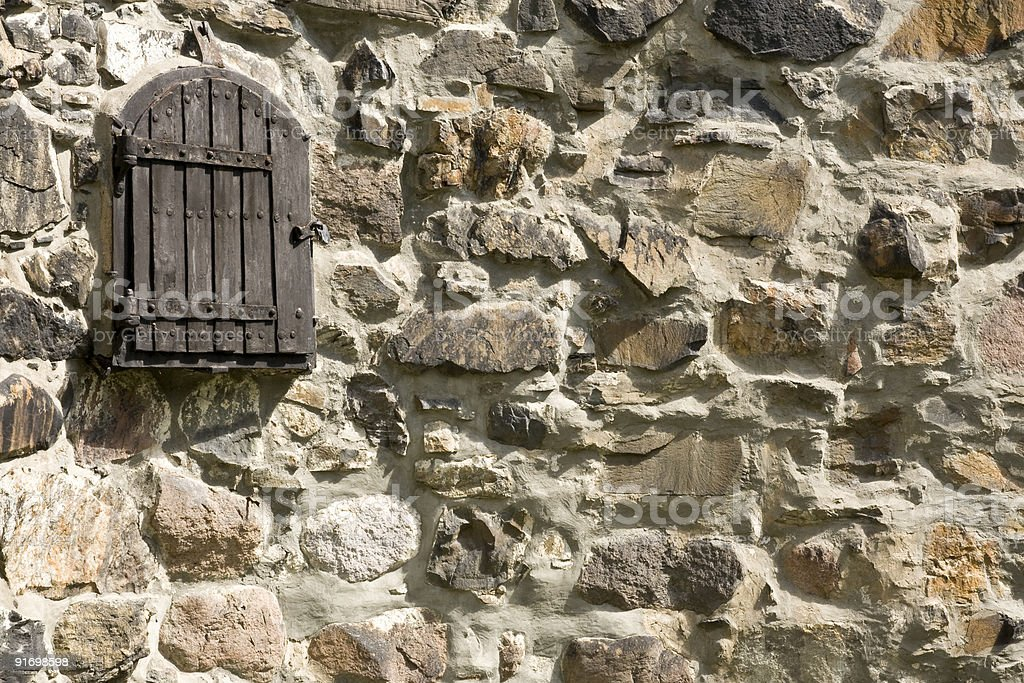 Window in a castel closed with shutter stock photo