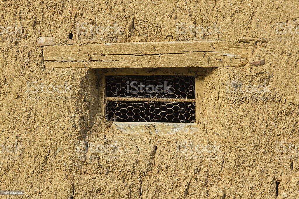 Window in Adobe House - Ventana en pared stock photo