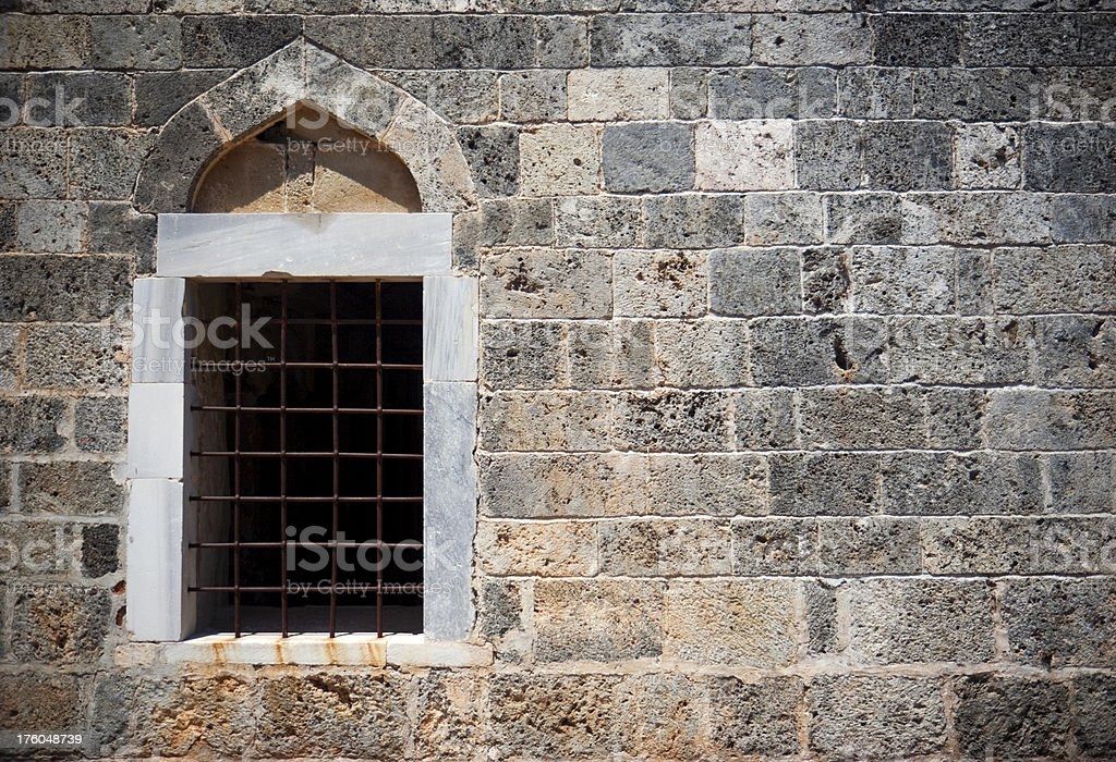 Window in an old church in the ghosttown Kayak, Turkey royalty-free stock photo