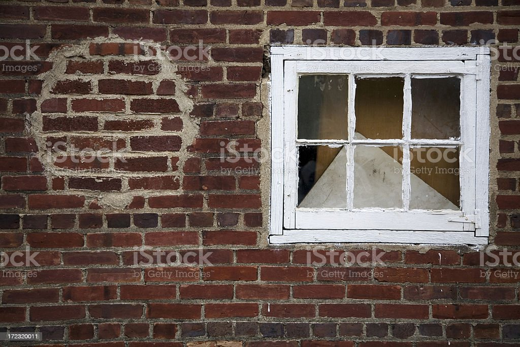 Window in Old Brick Wall with Repaired Hole royalty-free stock photo