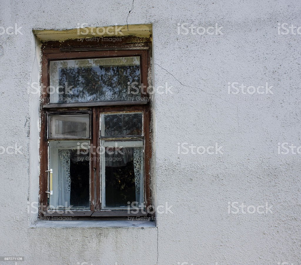 window in  old stained wall with cracks royalty-free stock photo