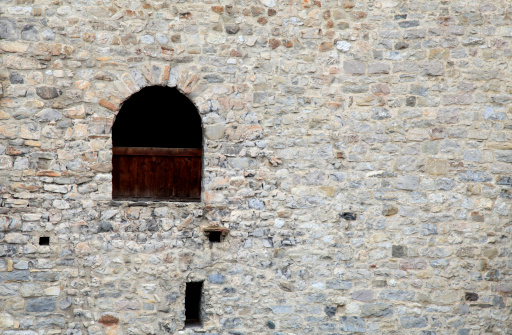 window in old stone  wall of medieval castle