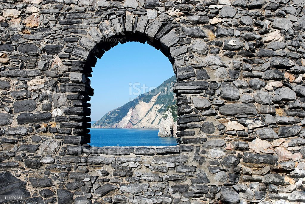 Window in the brick wall with beautiful seascape royalty-free stock photo