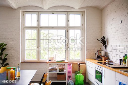 istock Window into sunny white European kitchen 489010472