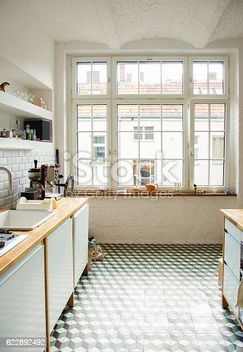 istock Window into white European kitchen vertical 622892492